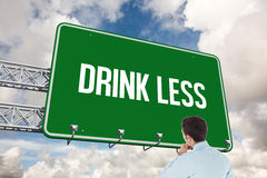 Drink less against blue sky with white clouds Royalty Free Stock Photo