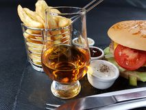 Drink alcohol bar beverage burger sauces blackplate blackbackground eat Royalty Free Stock Photo