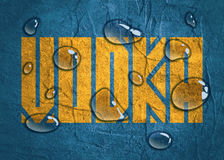 Drink alcohol beverage. Vodka word lettering. Concrete textured. Water drops Stock Images