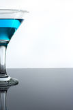Drink alcohol in a glass on the table. Blue drink alcohol in a glass on the table Stock Image