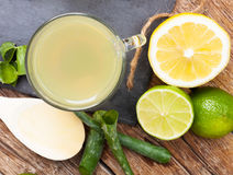 Drink with aloe vera and lemons. Glass cups on a slate tray from above Royalty Free Stock Photo