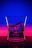 Drink in bar on black. Drink in bar on color abstract background Royalty Free Stock Photos