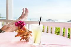 Drink at beach restaurant. Relaxing at a tropical beach restaurant with a cold drink stock photos