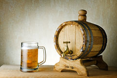 Beer and barrel on the wood table Royalty Free Stock Images