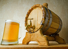 Beer and barrel on the wood table Stock Photo