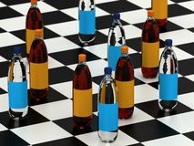 Drink bottles on a checker board Royalty Free Stock Photo