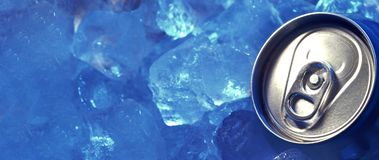 Drink can iced submerged in frost ice, metal aluminum beverage. Top of drink can iced submerged in frost ice, metal aluminum beverage royalty free stock images
