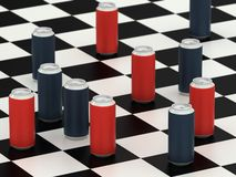 Drink cans on a checker board Stock Photo