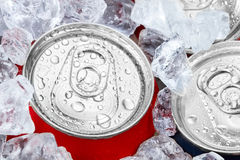 Drink cans in crushed ice stock photos