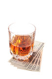 Drink and cash. Isolated on white background Royalty Free Stock Photo