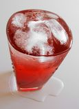 Drink close-up. Red drink with ice up close Royalty Free Stock Photography