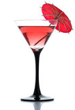 A drink with a cocktail umbrella Stock Images