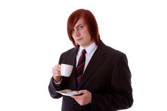 Drink coffee. Young man drinking a cup of coffee Stock Photography
