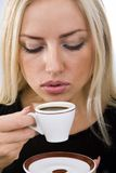 Drink of coffee. Portrait of pretty woman drinking a coffee Stock Image