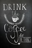 Drink the coffee, do the things. Typography poster, wall art print. Chalk lettering on the blackboard. Quote about. Coffee royalty free stock images