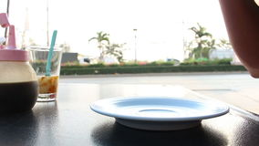 Drink coffee on traffic background. Close up drink coffee on traffic background stock video footage