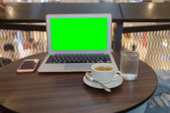 Drink coffee and working with labtop on table in coffee shop select focus, Close-up using his laptop in the Cofee Shop, Laptop gre Stock Image