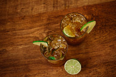 Drink concept - cocktail with cola ice cubes and lime Royalty Free Stock Photography