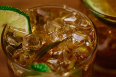 Drink concept - cocktail with cola ice cubes and lime Stock Image