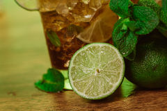 Drink concept - cocktail with  cola ice cubes and lime. Drink concept - cocktail with cola ice cubes and lime Stock Images