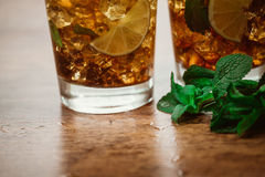 Drink concept - cocktail with  cola ice cubes and lime. Drink concept - cocktail with cola ice cubes and lime Stock Image