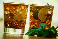 Drink concept - cocktail with  cola ice cubes and lime Royalty Free Stock Images
