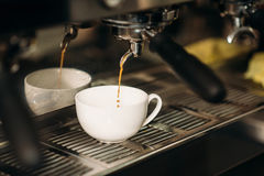 Drink cooking in a coffee machine. Stock Images