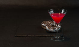 Drink cosmopolitan a glass of martini decorated with two oreo do Stock Photos