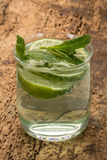 Drink decorated with lime and mint leaves Royalty Free Stock Photography