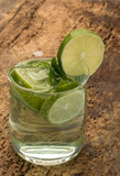 Drink decorated with lime and mint leaves Royalty Free Stock Photo