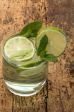 Drink decorated with lime and mint leaves Stock Image