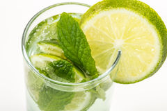 Drink decorated with sliced lime and mint Stock Image