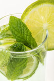 Drink decorated with sliced lime and mint Royalty Free Stock Image