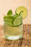 Drink decorated with sliced lime and mint Royalty Free Stock Photography