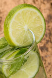 Drink decorated with sliced lime and mint Royalty Free Stock Images