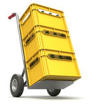 Drink delivery concept. With hand truck and plastic crate Stock Photography