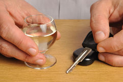 Drink and Drive. Someone with alcohol and car keys on a table Stock Photo