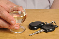 Drink and Drive. Someone with alcohol and car keys on a table Royalty Free Stock Photography