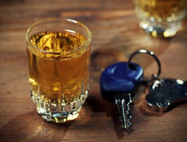 Drink and drive. Car keys  and a  whiskey shot Stock Photography