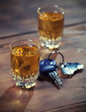 Drink and drive. Car keys  and a  whiskey shot Stock Photos