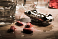Drink and drive danger - mini car crash on a table. Royalty Free Stock Photo