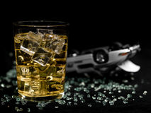 Drink and drive. Glass of alcohol on a blackground and an accident of simulated car Royalty Free Stock Images