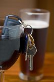 Drink driving. A image a set of car keys in a glass of wine focus on the keys Stock Photos