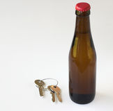 Drink driving. Beer bottle and set of keys isolated on a white background stock photo