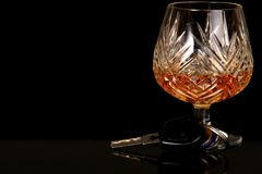 Drink driving. Image of car keys and a glass of alcohol representing the dangers of drink driving Stock Photos