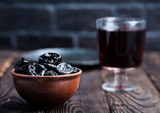 Drink and dry plums. Dry plums and drink in the glass Royalty Free Stock Photography