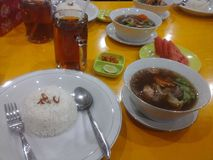 Drink&food. Let& x27;s to eat!!!sop buntut is the real indonesian food royalty free stock image