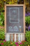 drink  and food menu and free wifi symbol written on blackboard Stock Image