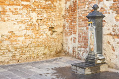 Drink fountain in public space of an italian city - image with c. Opy space Stock Image