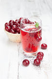 Drink with fresh cherries Royalty Free Stock Photos